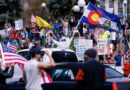 Photos show health care workers in masks blocking parade of lockdown protesters in Colorado